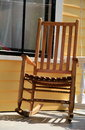 Comfortable Adirondack rocking chair on front porch Royalty Free Stock Photo