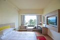 Comfortable bedroom with sea view reflected on television this is a typical hotel resort basic facility Royalty Free Stock Images