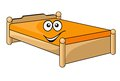 Comfortable cartoon bed with a colorful orange mattress with a happy smiling face isolated on white Royalty Free Stock Image