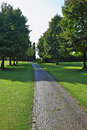 Comfortable path through the lawn walking goes green grassy most romantic landscape park garden in italy Royalty Free Stock Photography