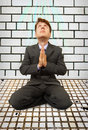 Comic businessman on knees praying Royalty Free Stock Images