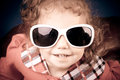 Comic funny little girl in big sunglasses Stock Photo