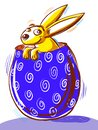 Gold Easter Bunny coming out of a purple Easter egg