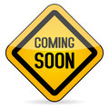 Coming soon yellow sign on white background Stock Images