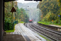 Coming train to station in west germany Stock Image