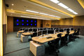 Command centre large with a big wall screen and work stations Royalty Free Stock Image