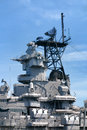 Command tower and weapons on us navy battleship with radar communication equipment above antiaircraft guns a Stock Image