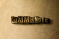 COMMANDER - close-up of grungy vintage typeset word on metal backdrop