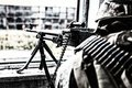 Commando machine gunner soldier firing from window Royalty Free Stock Photo
