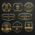 Commemorate golden labels design collection of set over black background Royalty Free Stock Photo