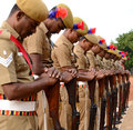 Commemoration day policemen with reversed arms paying homage to their colleagues who laid down their lives at the call of duty on Royalty Free Stock Photo