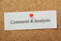 Comment analysis the words and typed on a piece of graph paper and pinned to a cork notice board Stock Image