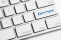 Comment button photo of on the white keyboard Royalty Free Stock Photos