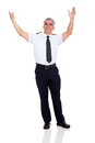 Commercial airline pilot cheerful senior arms up Royalty Free Stock Photos
