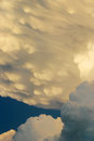 Commercial airplane appears tiny against dramatic thunderstorm clouds these developed directly overhead on a hot and humid kansas Royalty Free Stock Photos