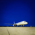 Commercial airplane at night parked Royalty Free Stock Image