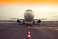 Commercial airplane parking at the airport, with traffic cone in Royalty Free Stock Photo