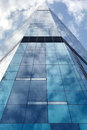 Commercial building in downtown district with cloud reflection Royalty Free Stock Photo