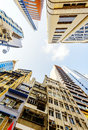 Commercial buildings and residential buildings in hong kong modern business with blue sky shot asia Royalty Free Stock Image