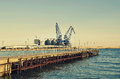 Commercial docks at sunset with a boat and cranes selective focus balchik bulgaria Royalty Free Stock Image