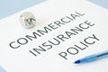 Commercial insurance policy on blue background Royalty Free Stock Photos
