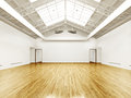 Commercial interior with hard wood floors and skylights Royalty Free Stock Photos