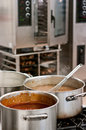 Commercial kitchen cauldrons of soup in a hotel or restaurant Stock Photos