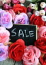 Commercial message of sale with roses in the background Stock Photo