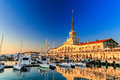 Commercial Sea Port of luxury yachts, motor and sailing boats, seaport in Black sea at sunset.