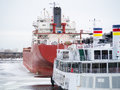 Commercial shipping vessel tour boat dock winter awaiting opening seaway Royalty Free Stock Images