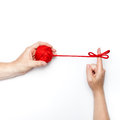 Commitment and personal responsibility conceptual photo with one hand holding ball with tangled ribbon on forefinger Stock Photo
