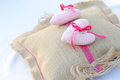 Commitment rings on pillow sackcloth burlap with two pink hearts Royalty Free Stock Photo