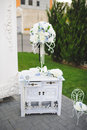 Commode with white bouquet decorated flower on stand Stock Image