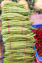 Common bean stack of fresh green tied with rubber band in the market Stock Photo