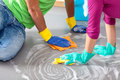 Common cleaning happy couple floor together in free day Stock Photos