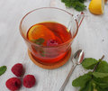 Common cure for common cold - lemon, mint, raspberry, ginger Royalty Free Stock Photo