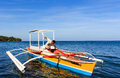 Common fishing vessel used by fishermen in the island of camiguin philippines Stock Photo