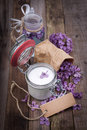 Common lilac perfume and cosmetics on wooden ground Stock Photo