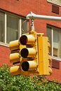 Common multi angle yellow traffic light old in north america usually used at busy and large crossroad Royalty Free Stock Photography