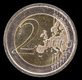 Common side of two euro coin on a black background Royalty Free Stock Photo