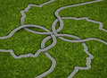 Common strategy business concept with a group of roads and highways in the shape of a human head coming together and merging into Royalty Free Stock Images