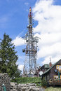 Communication antennas view of several kind of and a tower against beautiful deep blue sky with some white clouds on jaworzyna Royalty Free Stock Photo