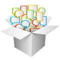 Communication concept talk bubbles flying out from white cardboard box Royalty Free Stock Images