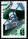 Communication satellite `Ekran-M`, Space Exploration serie, circa 1993 Royalty Free Stock Photo