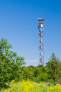 Communication tower on blue sky used to transmit radio tv and mobile signal Royalty Free Stock Photography