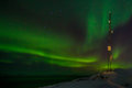 Communication tower and northern lights with a fjord Royalty Free Stock Photo