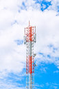 Communication tower over a blue sky cloudy Royalty Free Stock Images