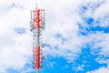 Communication tower over a blue sky cloudy Stock Photos