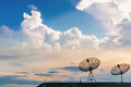Communications signals via a satellite dish Royalty Free Stock Photo
