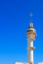 Communications tower with a beautiful blue sky Stock Photo